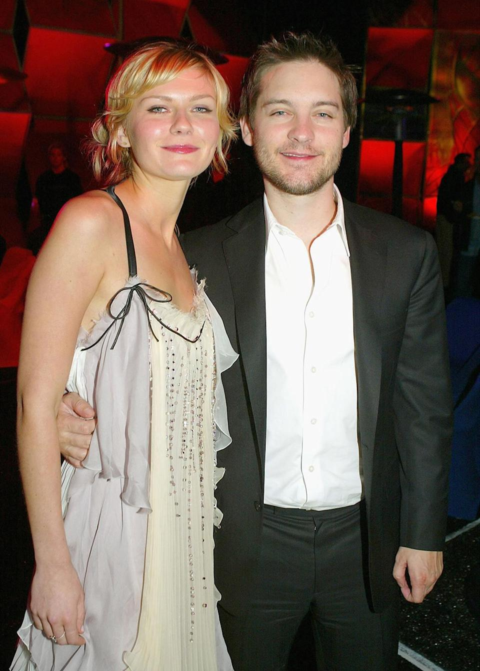 <p>Dunst and Maguire pose at the <em>Spider-Man 2</em> afterparty. (Photo: Kevin Winter/Getty Images) </p>
