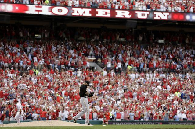 Pittsburgh Pirates pitcher A.J. Burnett walks off the mound after giving up a three-run home run to St. Louis Cardinals' Carlos Beltran in the third inning of Game 1 of baseball's National League division series on Thursday, Oct. 3, 2013, in St. Louis. (AP Photo/Jeff Roberson)