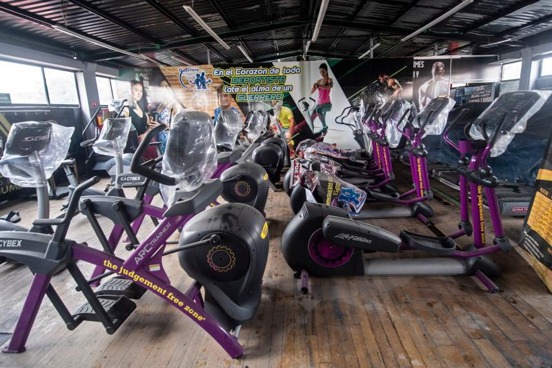 View of exercise equipment at a closed gym where a taco restaurant was set up in Mexico City, on August 17, 2020, amid the new coronavirus pandemic. - Six months after the arrival of the new coronavirus to Mexico, gyms are still closed in most of the country. (Photo by PEDRO PARDO / AFP) (Photo by PEDRO PARDO/AFP via Getty Images)