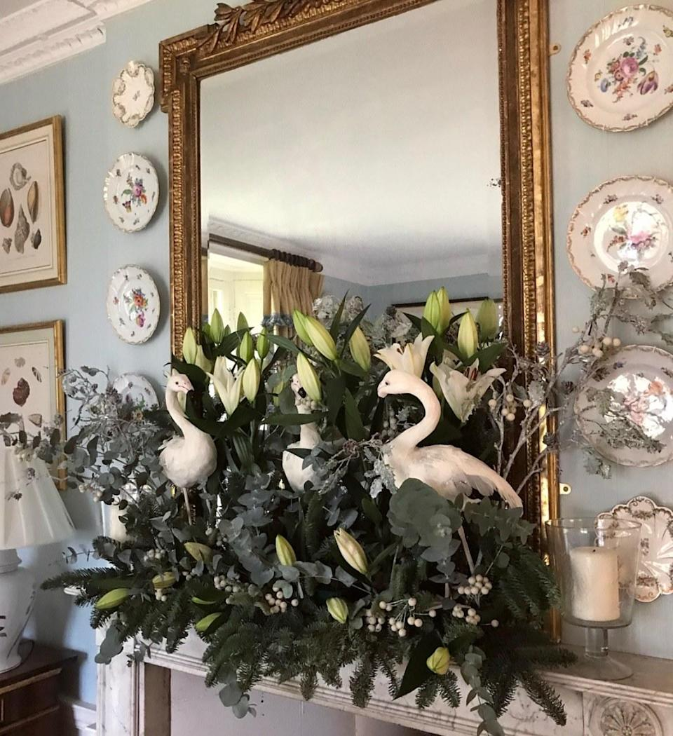 Our feathered friends perch pride of place in the dining room surrounded by lilies, berries, and crisp eucalyptus.