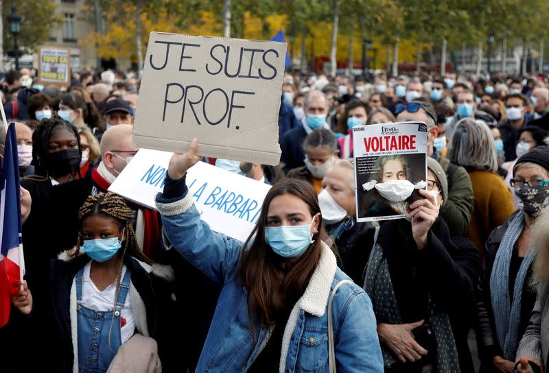 FILE PHOTO: People pay tribute to beheaded teacher Samuel Paty in Paris