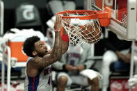 Detroit Pistons' Saddiq Bey makes a dunk against the Los Angeles Clippers during the first half of an NBA basketball game Sunday, April 11, 2021, in Los Angeles. (AP Photo/Jae C. Hong)