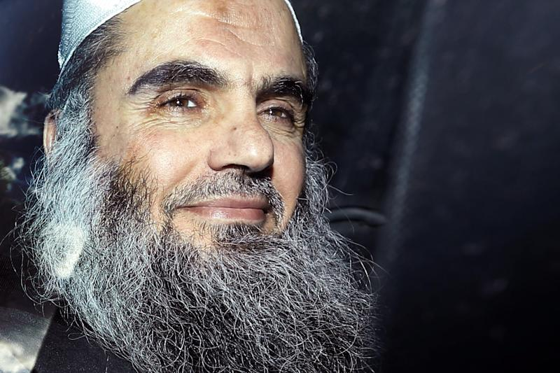 FILE - In this Tuesday, April 17, 2012 file photo, Abu Qatada is driven away after being refused bail at a hearing at London's Special Immigration Appeals Commission, which handles deportation and security cases, in London. A radical Islamist cleric accused in British and Spanish courts of being a senior al-Qaida figure is asking a London court to halt his extradition to Jordan, something British authorities have sought for a decade. Abu Qatada is taking his case Wednesday Oct. 10, 2012 to the Special Immigration Appeals Commission, which handles deportation and national security cases. He has fought attempts to extradite him since 2001, arguing that he could be tortured in Jordan, or could be tried using evidence obtained by torture.  (AP Photo/Matt Dunham, File)