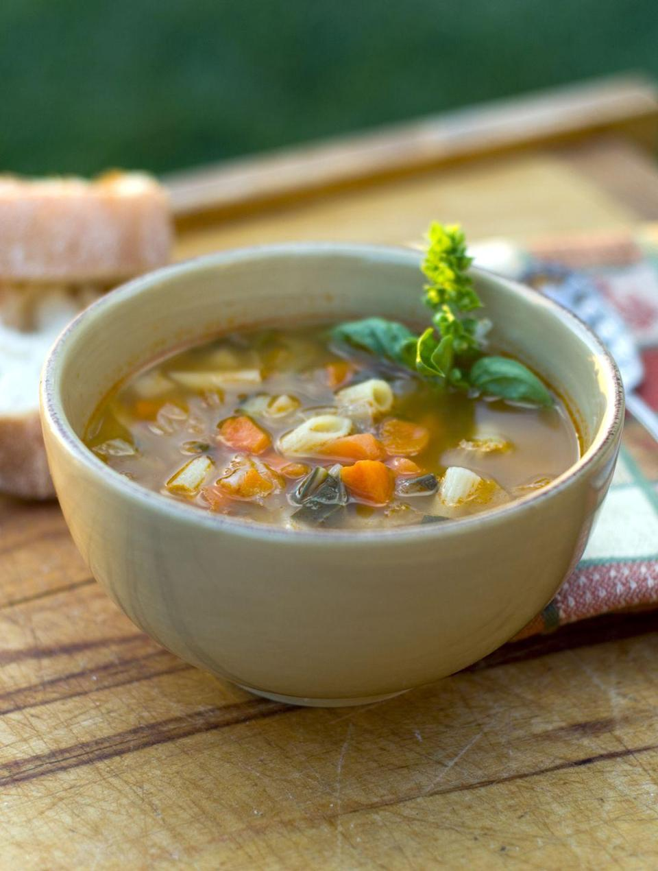 "<p><strong>Opt for a brothy soup like minestrone that has a ton of vegetables to help keep you fueled and satisfied.</strong> Read more about our <a href=""https://www.goodhousekeeping.com/food-products/g32613278/best-canned-soups/"" rel=""nofollow noopener"" target=""_blank"" data-ylk=""slk:favorite healthy soup brands here"" class=""link rapid-noclick-resp"">favorite healthy soup brands here</a>.</p>"