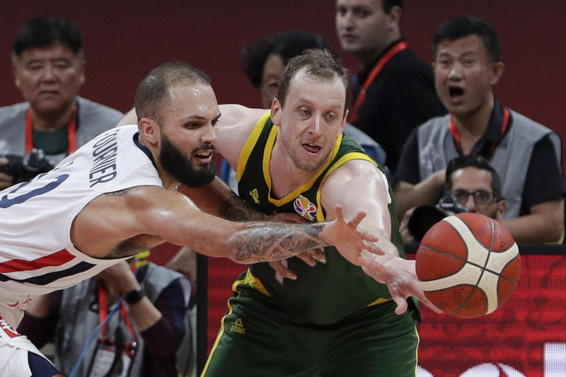 Joe Ingles of Australia and Evan Fournier of France battle the ball during their third placing match for the FIBA Basketball World Cup at the Cadillac Arena in Beijing, Saturday, Sept. 13, 2019. (AP Photo/Mark Schiefelbein)