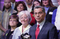U.S. Department of Health and Human Services (HHS) Secretary Xavier Becerra, right, speaks while surrounded by Oklahoma Medicaid advocates Thursday, July 1, 2021, in Tulsa, Okla., as Oklahoma expands its Medicaid program. (AP Photo/Sue Ogrocki)