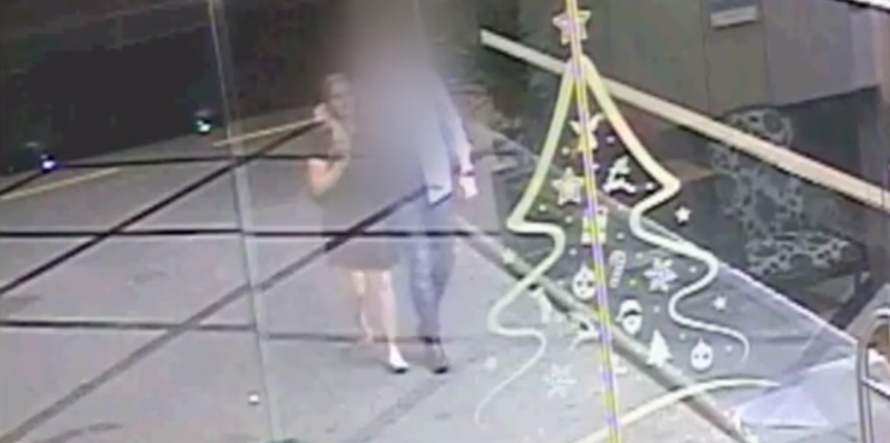 Backpacker Grace Millane with the accused's arm around her walking to his Auckland apartment.