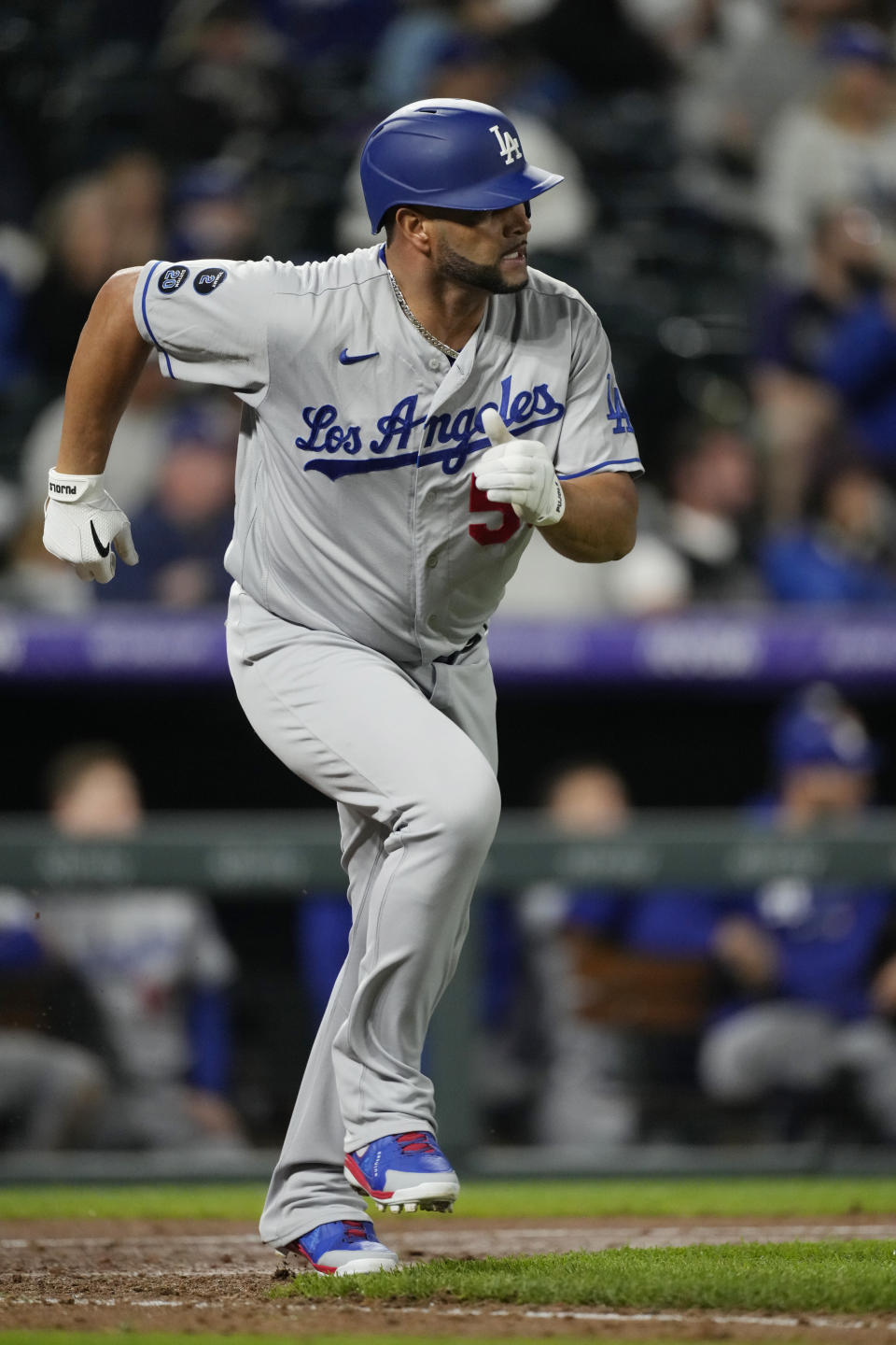 Los Angeles Dodgers pinch-hitter Albert Pujols heads up the first-base line after hitting an RBI-single off Colorado Rockies relief pitcher Jhoulys Chacin in the 10th inning of a baseball game Tuesday, Sept. 21, 2021, in Denver. The Dodgers won 5-4. (AP Photo/David Zalubowski)