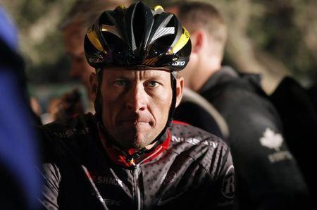 Seven time Tour de France winner Lance Armstrong awaits the start of the 2010 Cape Argus Cycle Tour in Cape Town