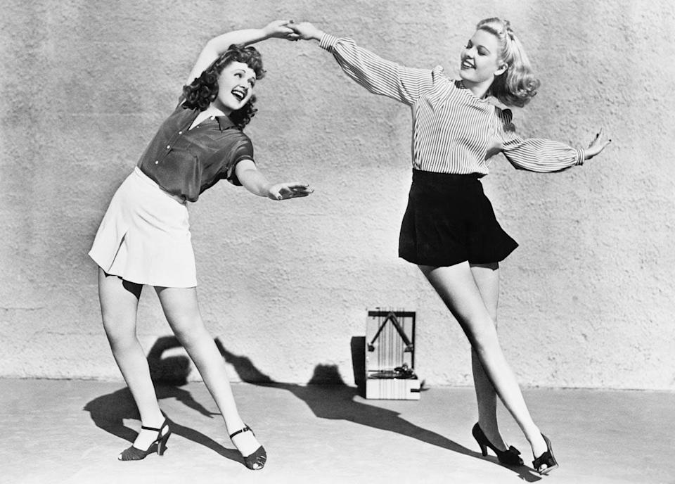 "<span class=""caption"">Wardrobe choices can be part of a delicate social dance.</span> <span class=""attribution""><a class=""link rapid-noclick-resp"" href=""https://www.shutterstock.com/image-photo/two-women-dancing-outside-100085954"" rel=""nofollow noopener"" target=""_blank"" data-ylk=""slk:Everett Collection/Shutterstock.com"">Everett Collection/Shutterstock.com</a></span>"