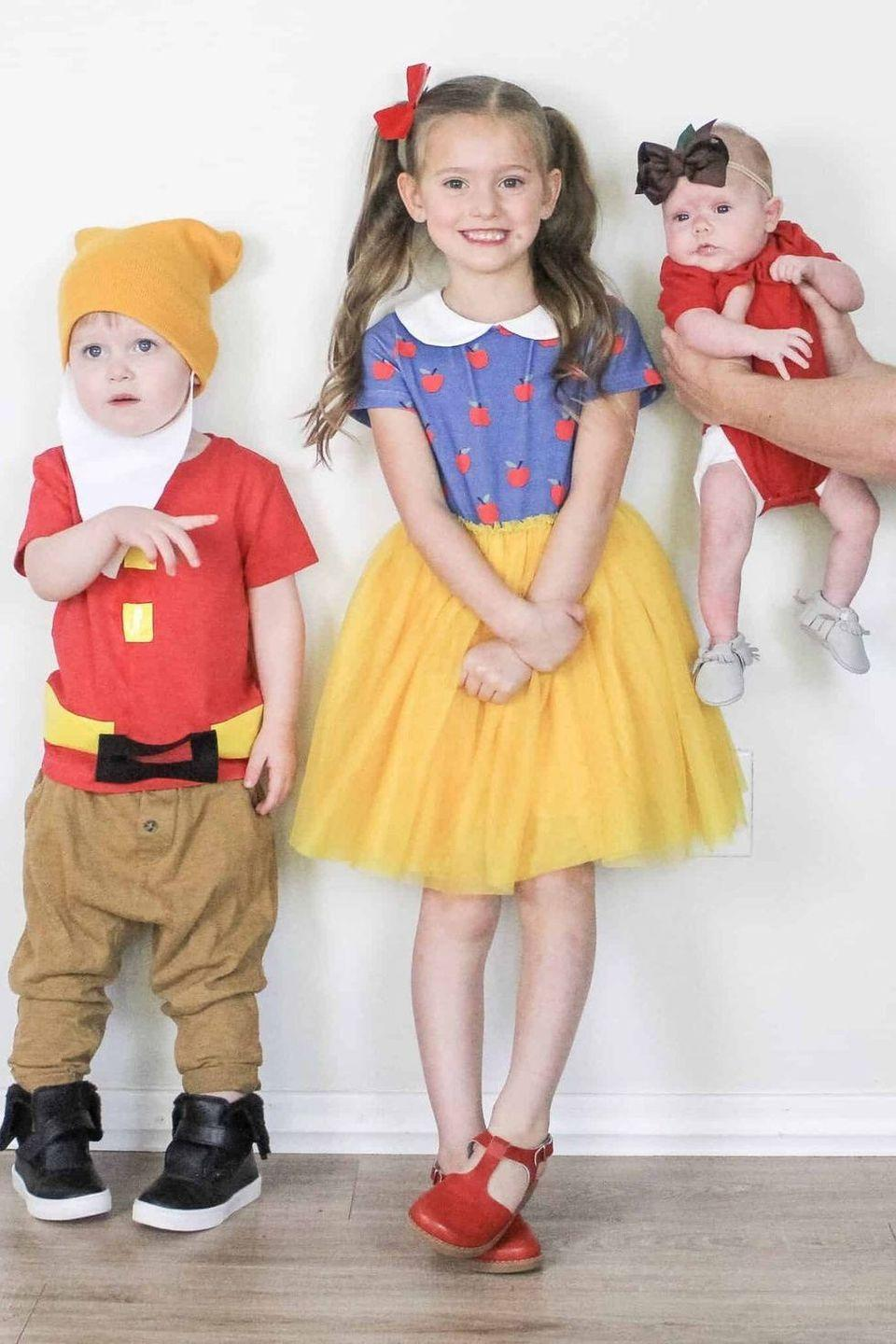 """<p>As you can see, this delightful Disney costume works well with three people—even babies can get in on the fun! But if you <em>really</em> want to win Halloween, we suggest grabbing four more friends and completing the dwarf family.</p><p><strong>Get the tutorial at <a href=""""https://arinsolangeathome.com/disney-outfits-for-girls/"""" rel=""""nofollow noopener"""" target=""""_blank"""" data-ylk=""""slk:Arin Solange at Home"""" class=""""link rapid-noclick-resp"""">Arin Solange at Home</a>.</strong></p><p><a class=""""link rapid-noclick-resp"""" href=""""https://go.redirectingat.com?id=74968X1596630&url=https%3A%2F%2Fwww.walmart.com%2Fsearch%2F%3Fquery%3Dsnow%2Bwhite%2Bcostumes&sref=https%3A%2F%2Fwww.thepioneerwoman.com%2Fhome-lifestyle%2Fcrafts-diy%2Fg37066817%2Fhalloween-costumes-for-3-people%2F"""" rel=""""nofollow noopener"""" target=""""_blank"""" data-ylk=""""slk:SHOP SNOW WHITE COSTUMES"""">SHOP SNOW WHITE COSTUMES</a></p>"""