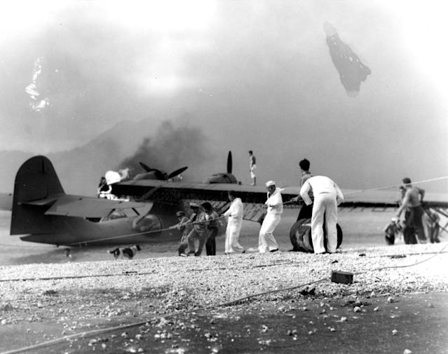 <p>Sailors attempt to save a burning PBY amphibious aircraft during the Japanese raid on Naval Air Station Kaneohe Bay, Hawaii, on Dec. 7, 1941. (U.S. Navy/U.S. Naval History and Heritage Command/Handout via Reuters) </p>