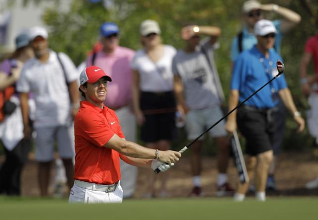 Rory McIlroy of Northern Ireland follows his ball on the 2nd hole during the 2nd round of DP World Golf Championship in Dubai, United Arab Emirates, Friday Nov. 15, 2013. (AP Photo/Kamran Jebreili)