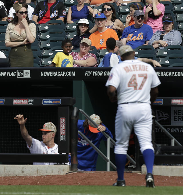 Fans watch as New York Mets pitcher Jose Valverde (47) leaves the field after giving up two runs to the Pittsburgh Pirates during the ninth inning of a baseball game, Monday, May 26, 2014, in New York. The Pirates won 5-3. (AP Photo/Julie Jacobson)