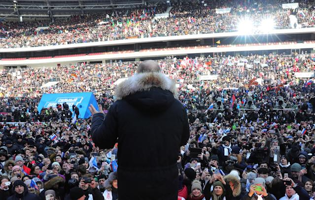 <p>Russia's President Vladimir Putin addresses a rally in his support at the Luzhniki Stadium ahead of the 2018 Russian presidential election scheduled for March 18. (Photo: Mikhail Klimentyev/TASS via Getty Images) </p>