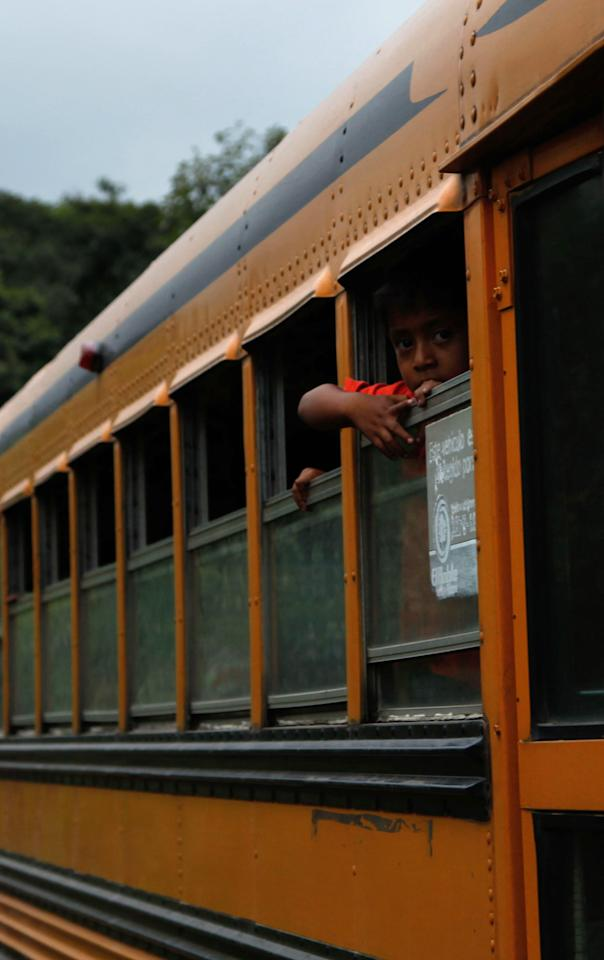 A boy peers from the window of a government provided bus during evacuations away from the Volcan del Fuego, or Volcano of Fire, to a shelter as they leave the village of Morelia, Guatemala, Thursday, Sept. 13, 2012. The long-simmering volcano exploded with a series of powerful eruptions outside one of Guatemala's most famous tourist attractions on Thursday, hurling thick clouds of ash in the air and spewing rivers of lava down its flanks. (AP Photo/Moises Castillo)