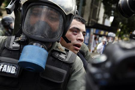 Venezuela's national guards detain an anti-government protester during a protest against President Nicolas Maduro's government in Caracas