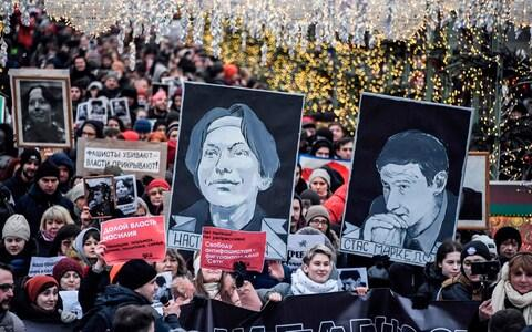 Russian opposition protesters march to commemorate the memories of lawyer Stanislav Markelov and journalist Anastasia Baburova - Credit: ALEXANDER NEMENOV/AFP via Getty Images