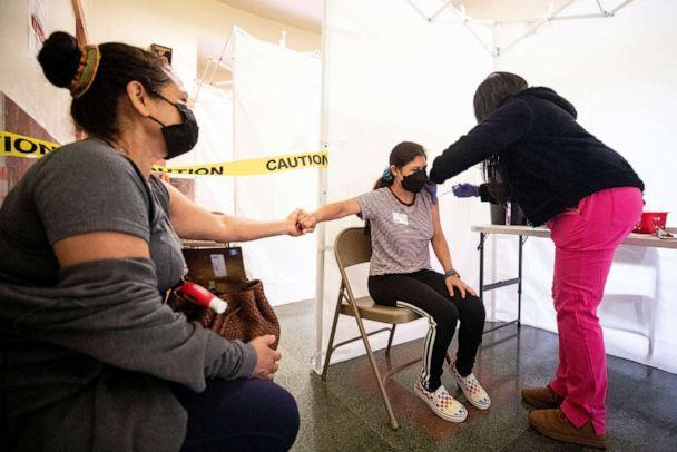 PHOTO: A 21-year-old receives a shot of COVID-19 vaccine during a vaccination drive organized by St. John's Well Child and Family at the Abraham Lincoln High School in Los Angeles, April 23, 2021. (Etienne Laurent/EPA via Shutterstock)