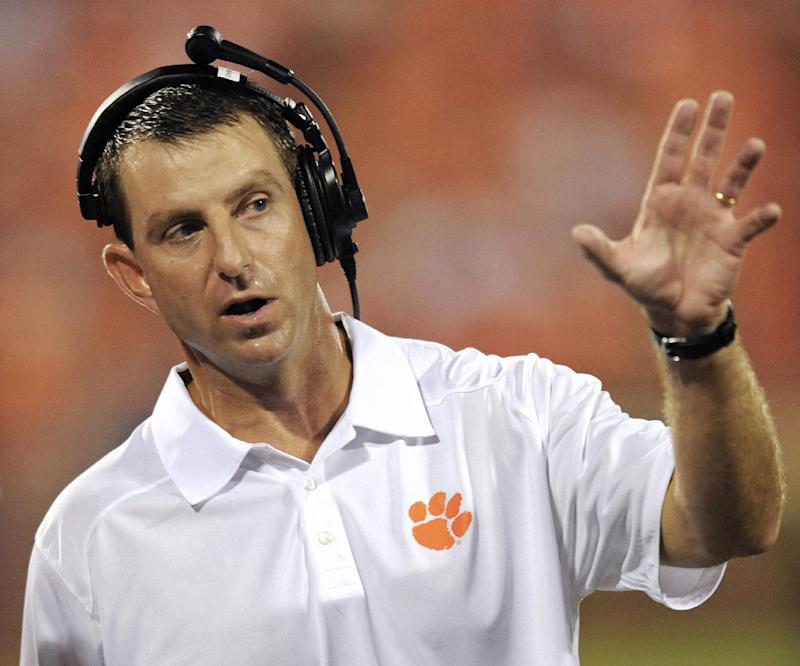 Clemson's Swinney gets 8-year deal, raise