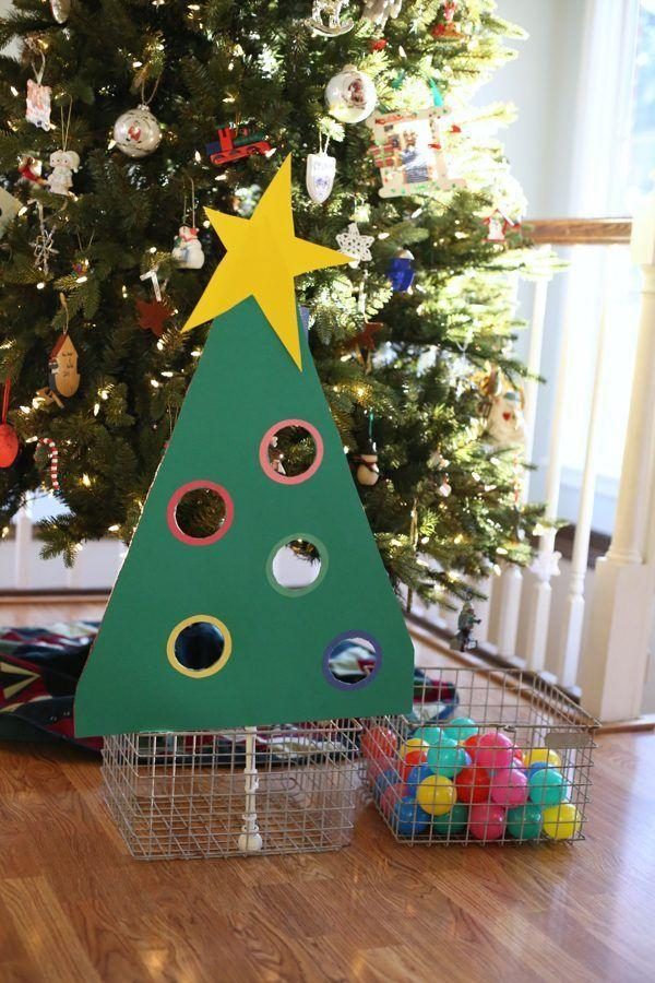 """<p>This toddler-appropriate sorting game will help your little one work on their categorization skills while getting into the holiday spirit. Use some sturdy card stock or poster board to make a cardboard tree with circular colored cutouts, and then ask your kiddos to put the ornaments through the appropriate spaces. </p><p><em><a href=""""http://www.icanteachmychild.com/christmas-tree-ball-sort-for-toddlers/"""" rel=""""nofollow noopener"""" target=""""_blank"""" data-ylk=""""slk:Get the tutorial at I Can Teach My Child »"""" class=""""link rapid-noclick-resp"""">Get the tutorial at I Can Teach My Child »</a></em><br></p>"""