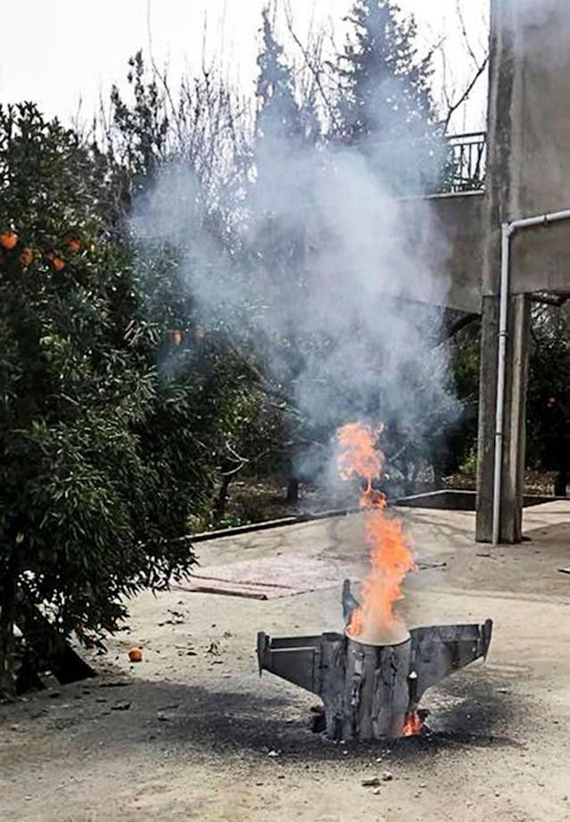 <p>Remnants of an unidentified rocket that did not explode fell at the house of Sheikh Ismail Amasha in the town of Hasbaya, south Lebanon, near the Lebanese-Israeli-Syrian borders, Feb. 10 2018.(Photo: Zyad Shoufi/EPA-EFE/REX/Shutterstock) </p>