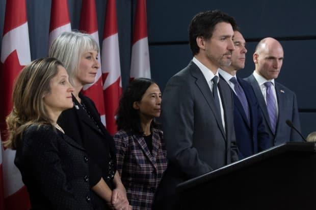 Prime Minister Justin Trudeau listens to a question with Deputy Prime Minister and Minister of Intergovernmental Affairs Chrystia Freeland, Minister of Health Patty Hajdu, Chief Medical Officer Theresa Tam, Minister of Finance Bill Morneau and President of the Treasury Board Jean-Yves Duclos during an early news conference on the pandemic in Ottawa on March 11, 2020.