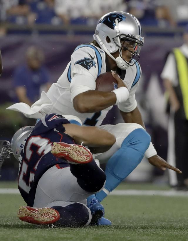 New England Patriots middle linebacker Kyle Van Noy, left, sacks Carolina Panthers quarterback Cam Newton in the first quarter of an NFL preseason football game, Thursday, Aug. 22, 2019, in Foxborough, Mass. (AP Photo/Elise Amendola)