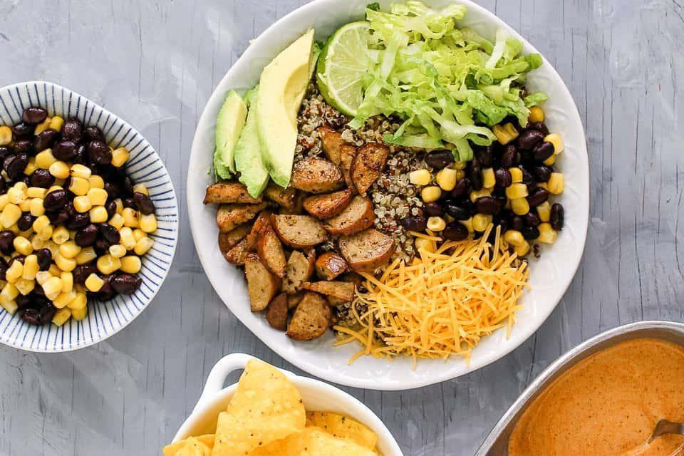 """<p>Soon-to-be moms, this one's for you. This burrito bowl takes no longer than 15 minutes to prepare and contains quinoa, a <a href=""""https://www.thedailymeal.com/foods-pregnant-women-need-to-eat?referrer=yahoo&category=beauty_food&include_utm=1&utm_medium=referral&utm_source=yahoo&utm_campaign=feed"""" rel=""""nofollow noopener"""" target=""""_blank"""" data-ylk=""""slk:must-add to any pregnancy diet"""" class=""""link rapid-noclick-resp"""">must-add to any pregnancy diet</a>. </p> <p><strong><a href=""""https://www.thedailymeal.com/recipes/15-minute-quinoa-burrito-bowls-recipe?referrer=yahoo&category=beauty_food&include_utm=1&utm_medium=referral&utm_source=yahoo&utm_campaign=feed"""" rel=""""nofollow noopener"""" target=""""_blank"""" data-ylk=""""slk:For the 15-Minute Quinoa Burrito Bowls recipe, click here."""" class=""""link rapid-noclick-resp"""">For the 15-Minute Quinoa Burrito Bowls recipe, click here.</a></strong></p>"""