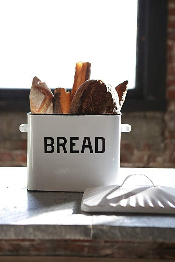 <p>You can even use this <span>Creative Co-op Enameled Metal Distressed White Bread Box With Lid</span> ($42, originally $72) to store cookbooks or utensils.</p>