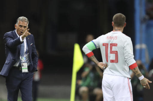 Iran head coach Carlos Queiroz, left, gestures to Spain's Sergio Ramos during the group B match between Iran and Spain at the 2018 soccer World Cup in the Kazan Arena in Kazan, Russia, Wednesday, June 20, 2018. (AP Photo/Thanassis Stavrakis)