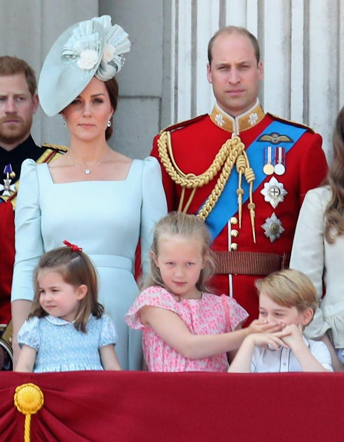 """<p><a href=""""https://www.townandcountrymag.com/society/tradition/g21240588/prince-george-princess-charlotte-trooping-the-colour-2018-photos/"""" rel=""""nofollow noopener"""" target=""""_blank"""" data-ylk=""""slk:Prince George and his cousin,"""" class=""""link rapid-noclick-resp"""">Prince George and his cousin,</a> Savannah Phillips, had a cute moment on the Buckingham Palace balcony during Trooping the Colour. </p>"""