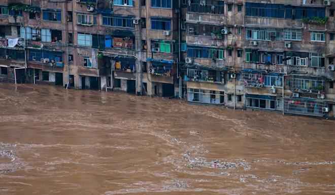A residential area in Qijiang district is one of the flood-hit areas in Chongqing, where more than 40,000 people have been evacuated. Photo: Xinhua