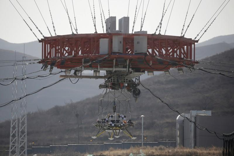 Lander is hanged for a hovering-and-obstacle avoidance test for China's Mars mission at a test facility in Huailai