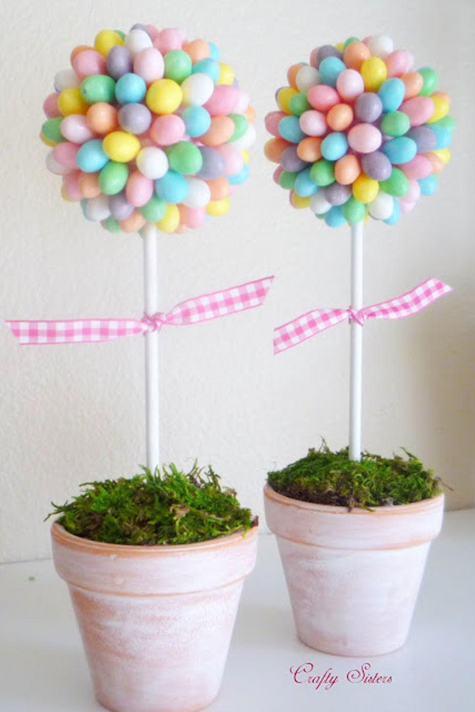 "<p>Give your mantel or kitchen island some springtime flair with these easy-to-make, pastel pieces.</p><p><strong>Get the tutorial at <a href=""http://craftysisters-nc.blogspot.com.br/2010/03/jelly-bean-topiary.html"" rel=""nofollow noopener"" target=""_blank"" data-ylk=""slk:Crafty Sisters"" class=""link rapid-noclick-resp"">Crafty Sisters</a>.</strong></p><p><a class=""link rapid-noclick-resp"" href=""https://www.amazon.com/Brachs-Speckled-Jelly-Beans-Pounds/dp/B071H7XP6K/ref=sxts_sxwds-bia-wc-rsf-lq2a3_0?tag=syn-yahoo-20&ascsubtag=%5Bartid%7C10050.g.1652%5Bsrc%7Cyahoo-us"" rel=""nofollow noopener"" target=""_blank"" data-ylk=""slk:SHOP JELLY BEANS"">SHOP JELLY BEANS</a></p>"