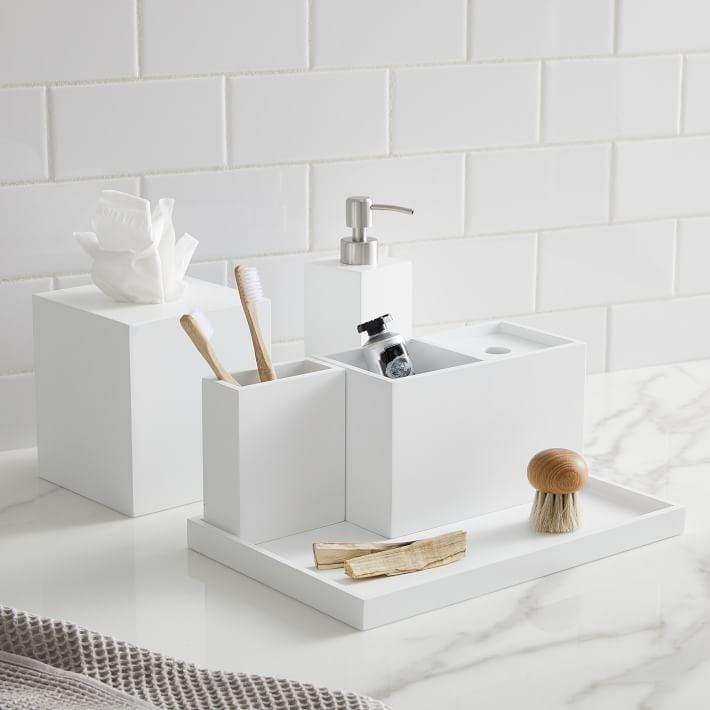 <p>We love the modern look of this <span>West Elm Lacquer Bath Accessories</span> ($13 and up).</p>