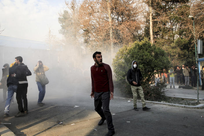 <p>In this photo taken by an individual not employed by the Associated Press and obtained by the AP outside Iran, university students attend a protest inside Tehran University while a smoke grenade is thrown by anti-riot Iranian police, in Tehran, Iran, Saturday, Dec. 30, 2017. (Photo: AP) </p>