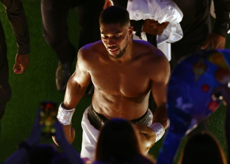 Beaten - Anthony Joshua leaves the arena after losing his world heavyweight titles to Oleksandr Usyk following a unanimous points defeat at the Tottenham Hotspur Stadium (AFP/Adrian DENNIS)