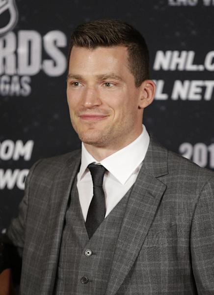 Andrew Ference of the Edmonton Oilers poses on the red carpet before the NHL Awards on Tuesday, June 24, 2014, in Las Vegas. (AP Photo/John Locher)
