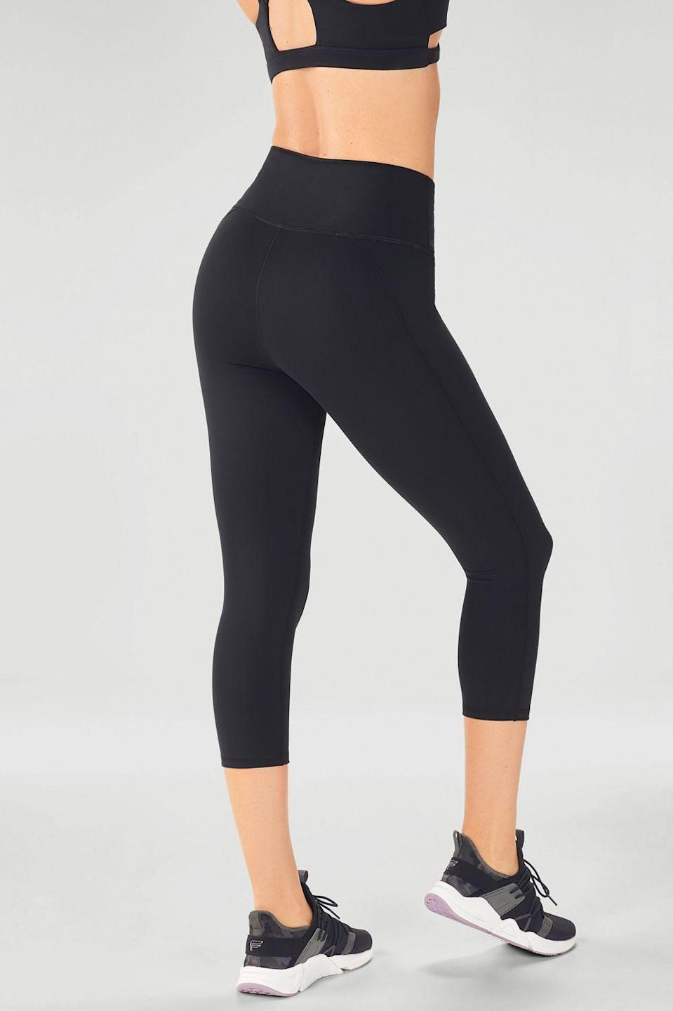 """<h3><h2>Fabletics High-Waisted PowerHold 7/8</h2></h3><br><strong><em>Overall Score: 4.45</em></strong><em><br></em><br><strong>Stretch: 4.5</strong><br>Disclaimer: The """"workout"""" I tried out my Fabletics leggings in was actually moving all of my belongings and furniture back into my room after redoing the floors. Still, I'd count that as a form of exercise! I love a super tight legging (nothing bothers me more than having to pull up the waistband mid-workout) and the Fabletics ones I had on stayed put, even through all the pushing and pulling. There was still enough stretch to feel comfortable in them.<br><br><strong>Sweat wicking: 4.0</strong><br>I'll be honest — I worked up a little bit of a sweat moving the entirety of my belongings from one area of my house to the other. But, I still felt fresh and clean — or at least as much as I possibly could have been in that situation.<br><br><em>— Lizzy Gulino, Health & Wellness Writer</em><br><br><strong>Fabletics</strong> High-Waisted PowerHold® 7/8, $, available at <a href=""""https://go.skimresources.com/?id=30283X879131&url=https%3A%2F%2Fwww.fabletics.com%2Fproducts%2FHIGH-WAISTED-POWERHOLD-7-8-CS1719629-0001"""" rel=""""nofollow noopener"""" target=""""_blank"""" data-ylk=""""slk:Fabletics"""" class=""""link rapid-noclick-resp"""">Fabletics</a>"""