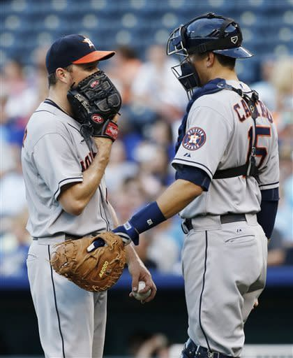Houston Astros starting pitcher Erik Bedard talks with catcher Jason Castro, right, during the fourth inning of a baseball game against the Kansas City Royals at Kauffman Stadium in Kansas City, Mo., Saturday, June 8, 2013. (AP Photo/Orlin Wagner)