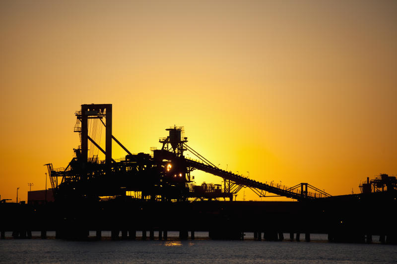 Silhouette of a bucket wheel reclaimer at an iron ore mine