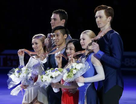 Figure Skating - ISU World Championships 2017 - Pairs Victory Ceremony - Helsinki, Finland - 30/3/17 - Gold medallists Sui Wenjing and Han Cong of China (C), silver medallists Aliona Savchenko and Bruno Massot of Germany (L) and bronze medallists Evgenia Tarasova and Vladimir Morozov of Russia attend the ceremony. REUTERS/Grigory Dukor