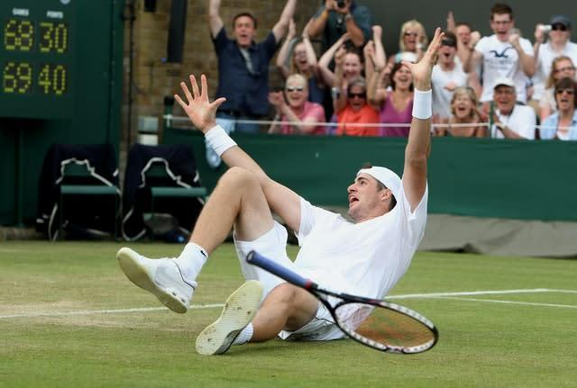 Isner celebrates his famous victory after finally breaking Mahut's serve in the fifth set – two days after they started the match (PA)
