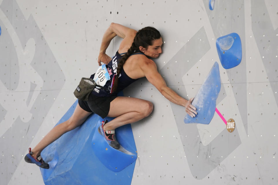 Kyra Condie climbs during women's boulder qualification at the climbing World Cup. - Credit: Rick Bowmer/AP