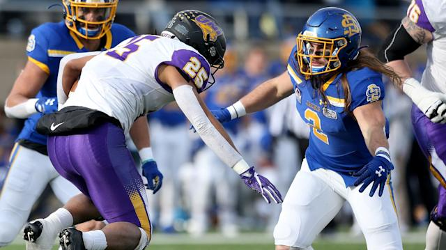 BROOKINGS, SD - DECEMBER 7: Trevor Allen #25 of the Northern Iowa Panthers is about to run into the wall of Christian Rozeboom #2 of the South Dakota State Jackrabbits during their FCS Playoff game Saturday afternoon at Dana J. Dykhouse Stadium in Brookings, SD. (Photo by Dave Eggen/Inertia)