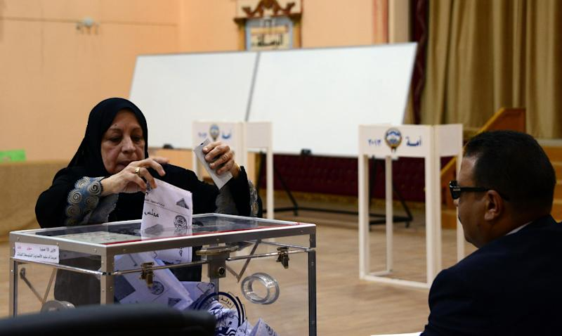 A Kuwaiti woman cast her vote at a polling station in Salwa, Kuwait on Saturday, July 27, 2013. Kuwaiti voters braved searing heat in the middle of the Ramadan fast to cast ballots in parliamentary elections that leaders in the oil-rich Gulf nation hope can restore stability after years of confrontations between its Western-backed rulers and an Islamist-led opposition. (AP Photo/Gustavo Ferrari)