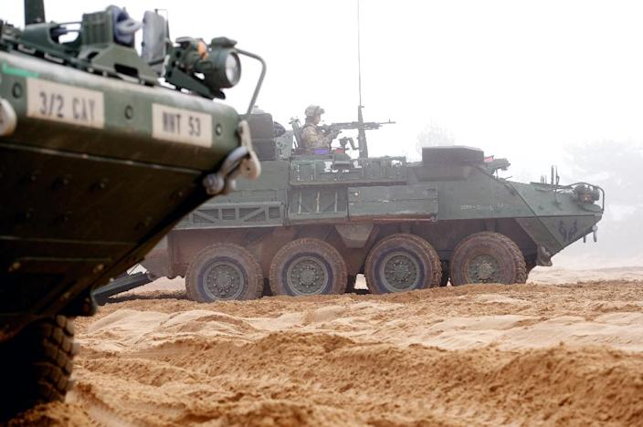 An armored fighting vehicle IAV Stryker of the US Cavalry Regiment 2nd subdivision is seen during a partner training with Latvian and Canadian soldiers at the Adazi military training area in Latvia on February 26, 2015 (AFP Photo/Ilmars Znotins)