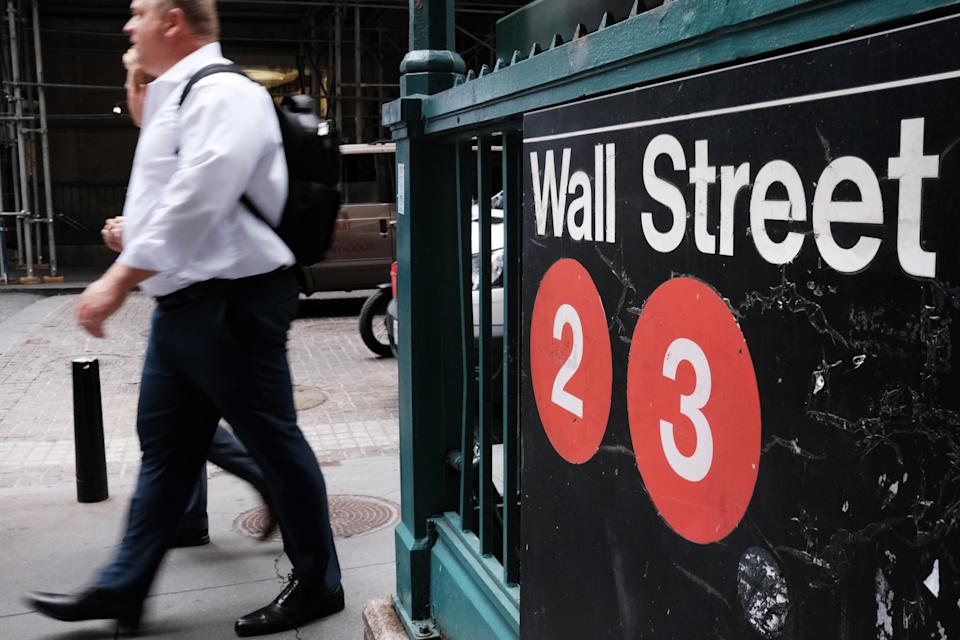 NEW YORK, NEW YORK - SEPTEMBER 16: People walk along Wall St. on September 16, 2021 in New York City. Despite a rise in retail sales, the Dow slipped lower on Thursday as investors continue to have concerns from the Delta variant and news of a slight rise in jobless claims.  (Photo by Spencer Platt/Getty Images)