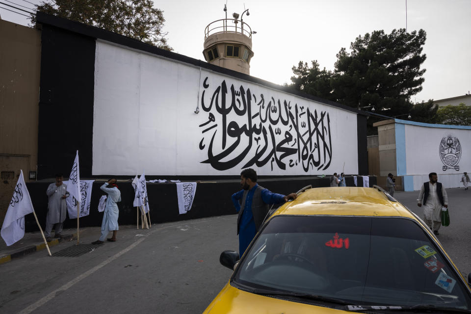 The iconic Taliban flag is painted on a wall outside the American embassy compound in Kabul, Afghanistan, Saturday, Sept. 11, 2021. (AP Photo/Bernat Armangue)